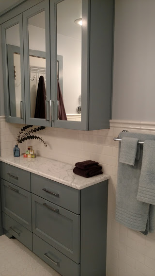 Custom Blue Painted Vanity and bath storage